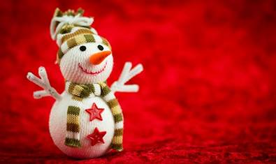 Smiling snowman doll with pipe cleaner arms.