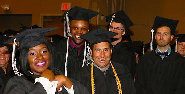 GSU Graduates smiling at the 2016 Commencement Ceremony
