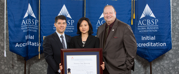 Jun Zhao, center, Division Chair, CBPA Management Marketing & Public Relations, accepts the accreditation certificate on behalf of the CBPA from Jose David Marin Enriquez (left), Chair, ACBSP Board of Commissioners, Baccalaureate/Graduate Degree, and Steve Pascale, ACBSP Chief Accreditation Officer.